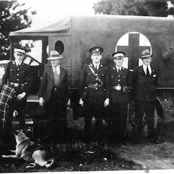 Waihi Ambulance 1931. Left to right: Sid Birse, Tom Williams, Harry Birse, Fred Carbutt.