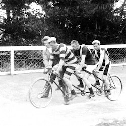 On the cycle track, Waihi. William Oates at rear. Three cyclists in tandem.